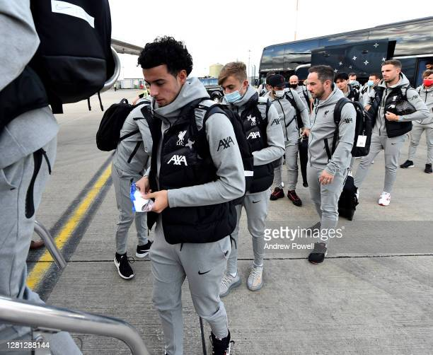 Curtis Jones of Liverpool boarding a plane ^ahead of the UEFA Champions League Group D stage match between Liverpool FC and Ajax Amsterdam at...