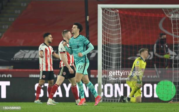 Curtis Jones of Liverpool celebrates after scoring their side's first goal during the Premier League match between Sheffield United and Liverpool at...