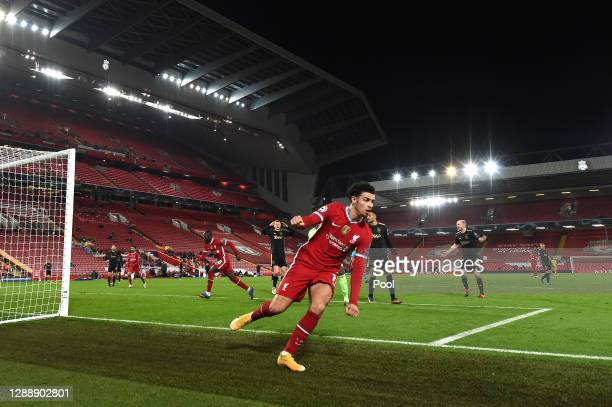 Curtis Jones of Liverpool celebrates after scoring their team's first goal during the UEFA Champions League Group D stage match between Liverpool FC...
