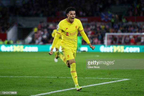 Curtis Jones of Liverpool celebrates after scoring their team's third goal during the Premier League match between Brentford and Liverpool at...