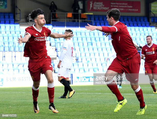 Curtis Jones of Liverpool celebrates his first gaol with team mate Liam Millar during the UEFA Champions League group E match between Liverpool FC...