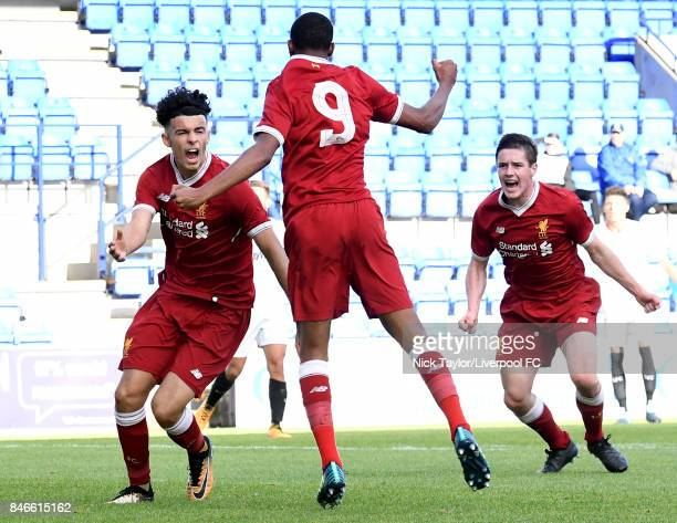 Curtis Jones of Liverpool celebrates his first gaol with team mates Rhian Brewster and Liam Coyle during the UEFA Champions League group E match...
