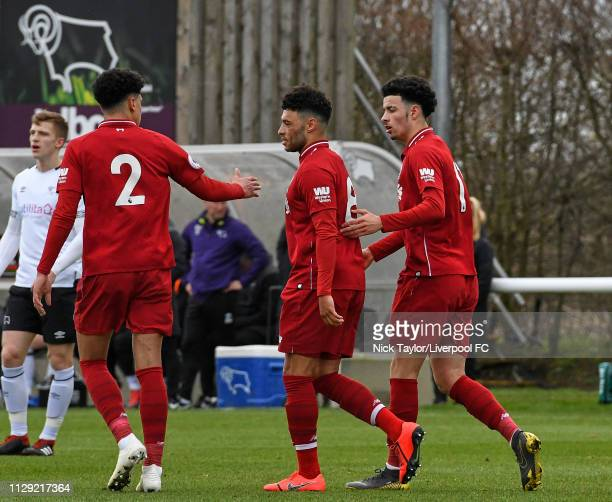 Curtis Jones of Liverpool celebrates his goal with Alex OxladeChamberlain during the PL2 game at Derby County Training Ground on March 8 2019 in...