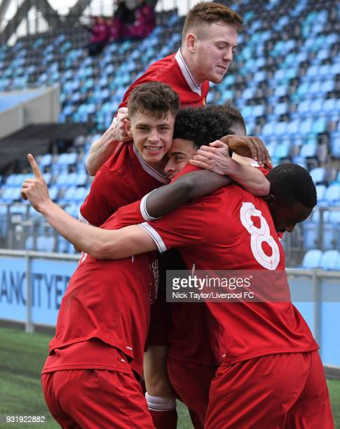 Curtis Jones of Liverpool celebrates his goal with team mates Bobby Adekanye Adam Lewis George Johnston and Rafael Camacho during the Manchester City...