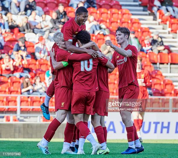 Curtis Jones of Liverpool celebrates scoring Liverpool's third goal with team mates Luis Longstaff Rhian Brewster and Morgan Boyes during the UEFA...
