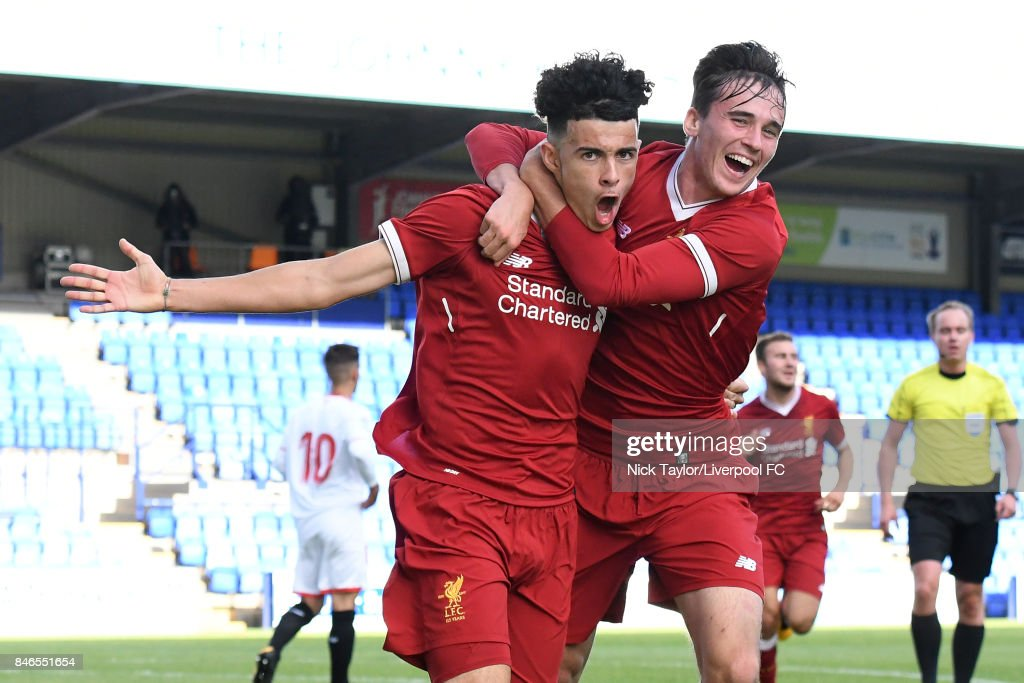 Curtis Jones (left) of Liverpool celebrates scoring the first goal with team mate Liam Millar during the UEFA Champions League group E match between Liverpool FC and Sevilla FC at Prenton Park on September 13, 2017 in Birkenhead, United Kingdom.