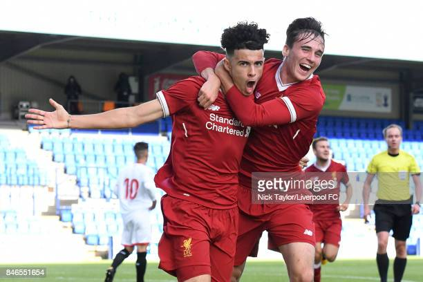 Curtis Jones of Liverpool celebrates scoring the first goal with team mate Liam Millar during the UEFA Champions League group E match between...