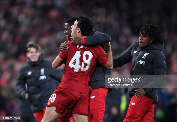 Curtis Jones of Liverpool celebrates scoring the winning penalty during the Carabao Cup Round of 16 match between Liverpool and Arsenal at Anfield on...