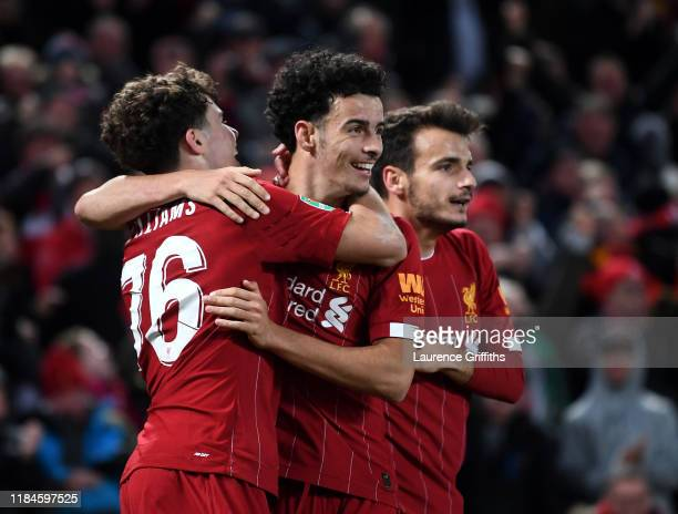Curtis Jones of Liverpool celebrates the fifth goal with Neco Williams during the Carabao Cup Round of 16 match between Liverpool and Arsenal at...