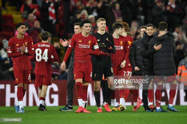 Curtis Jones of Liverpool celebrates victory with Caoimhin Kelleher after the FA Cup Fourth Round Replay match between Liverpool FC and Shrewsbury...