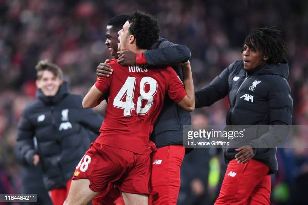 Curtis Jones of Liverpool celebrates victory with his team mates after scoring his sides fourth penalty during the penalty shoot out during the...
