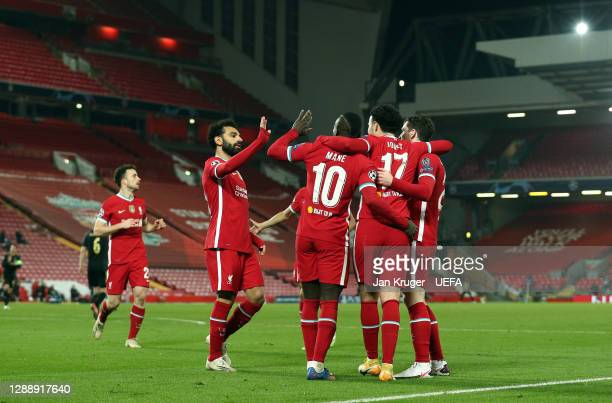 Curtis Jones of Liverpool celebrates with team mates after scoring his team's first goal during the UEFA Champions League Group D stage match between...