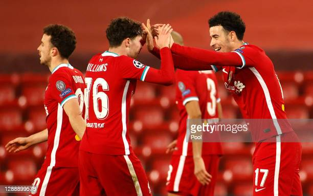 Curtis Jones of Liverpool celebrates with teammate Neco Williams after scoring his team's first goal during the UEFA Champions League Group D stage...