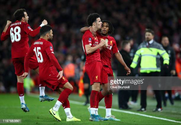 Curtis Jones of Liverpool celebrates with teammates after scoring his team's first goal during the FA Cup Third Round match between Liverpool and...