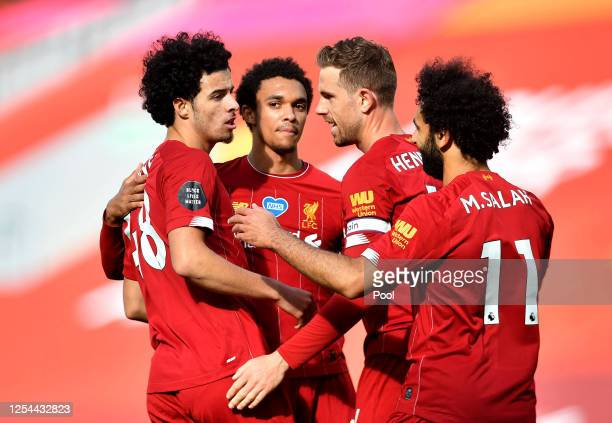 Curtis Jones of Liverpool celebrates with teammates after scoring his team's second goal during the Premier League match between Liverpool FC and...