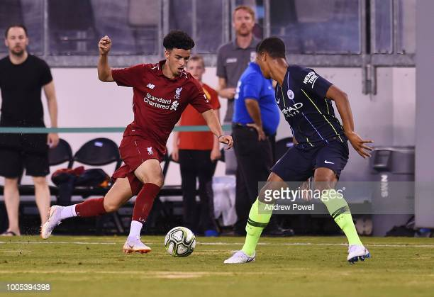 Curtis Jones of Liverpool competes with Cameron Humphreys of Manchester City during the International Champions Cup 2018 match between Manchester...