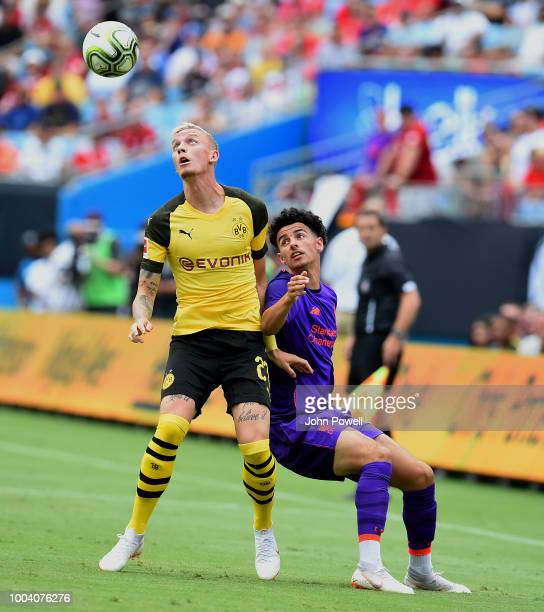 Curtis Jones of Liverpool competes with Marius Wolf of Borussia Dortmund during the International Champions Cup 2018 match between Liverpool and...