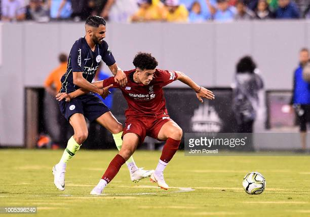 Curtis Jones of Liverpool competes with Riyad Mahrez of Manchester City during the International Champions Cup 2018 match between Manchester City and...