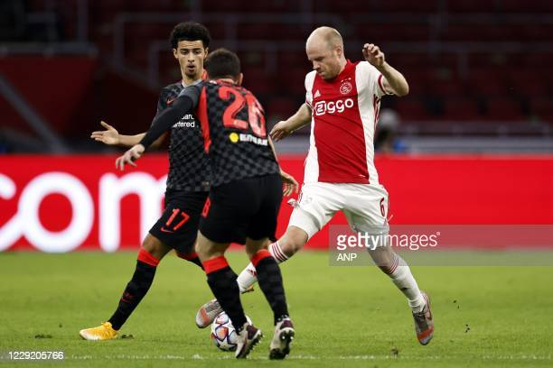AMSTERDAM Curtis Jones of Liverpool FC Andy Robertson of Liverpool FC Davy Klaassen or Ajax during the UEFA Champions League match in group D between...