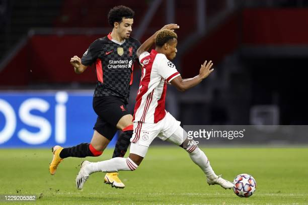 AMSTERDAM Curtis Jones of Liverpool FC David Neres or Ajax during the UEFA Champions League match in group D between Ajax Amsterdam and Liverpool FC...