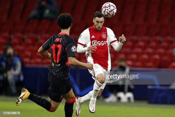 AMSTERDAM Curtis Jones of Liverpool FC Nico Tagliafico or Ajax during the UEFA Champions League match in group D between Ajax Amsterdam and Liverpool...