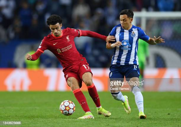 Curtis Jones of Liverpool holds off Pepe of FC Porto during the UEFA Champions League group B match between FC Porto and Liverpool FC at Estadio do...