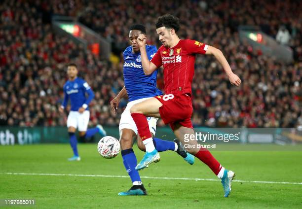 Curtis Jones of Liverpool is challenged by Yerry Mina of Everton during the FA Cup Third Round match between Liverpool and Everton at Anfield on...