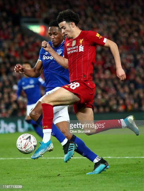 Curtis Jones of Liverpool is challenged by Yerry Mina of Everton during the FA Cup Third Round match between Liverpool FC and Everton FC at Anfield...