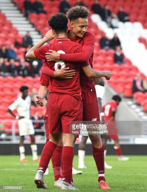 Curtis Jones of Liverpool is congratulated by Rhys Williams after scoring during the UEFA Youth League game at Langtree Park on September 18 2018 in...