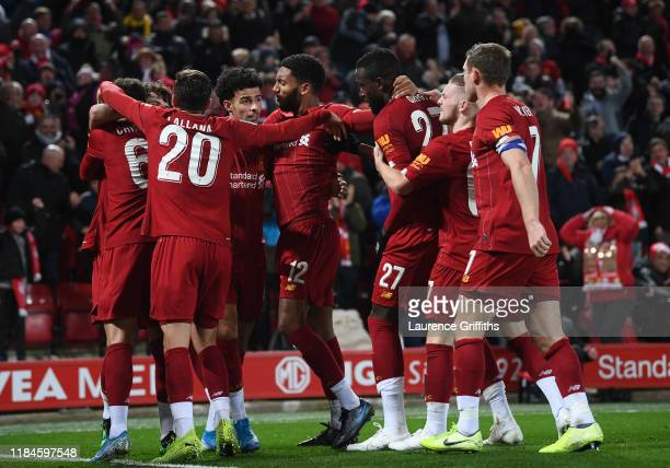 Curtis Jones of Liverpool is congratulates on his assist for the fifth goal during the Carabao Cup Round of 16 match between Liverpool and Arsenal at...