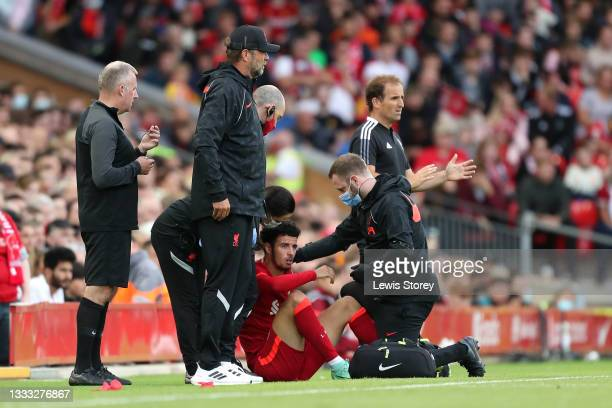 Curtis Jones of Liverpool looks dejected as he receives medical treatment for an injury before being substituted during the Pre-Season Friendly match...
