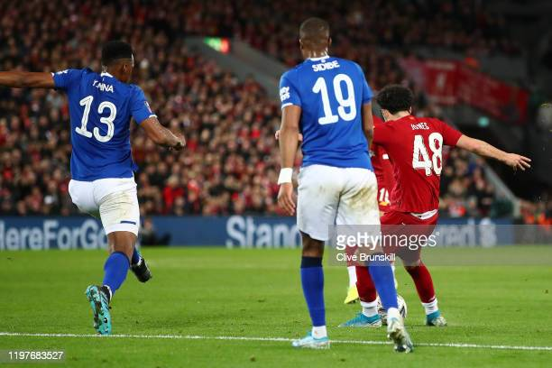 Curtis Jones of Liverpool scores his team's first goal during the FA Cup Third Round match between Liverpool and Everton at Anfield on January 05...