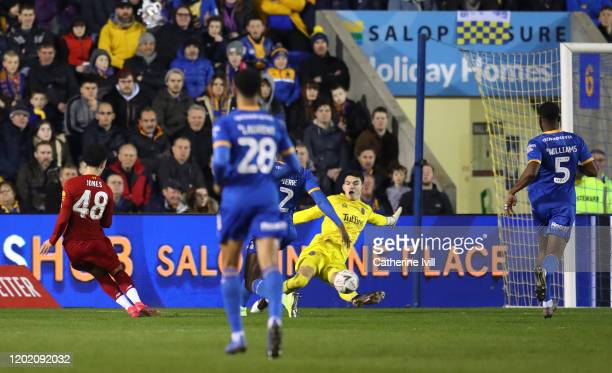Curtis Jones of Liverpool scores his team's first goal during the FA Cup Fourth Round match between Shrewsbury Town and Liverpool at New Meadow on...