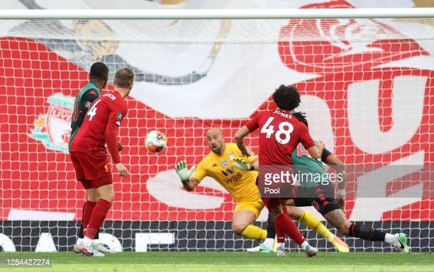 Curtis Jones of Liverpool scores his team's second goal past Pepe Reina of Aston Villa during the Premier League match between Liverpool FC and Aston...