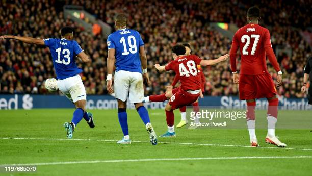 Curtis Jones of Liverpool scores the opening goal during the FA Cup Third Round match between Liverpool FC and Everton at Anfield on January 05 2020...