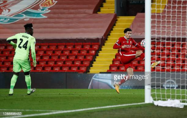 Curtis Jones of Liverpool scores their team's first goal during the UEFA Champions League Group D stage match between Liverpool FC and Ajax Amsterdam...