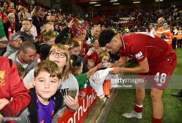 Curtis Jones of Liverpool signing autographs at the end of the PreSeason friendly match between Liverpool and Torino at Anfield on August 7 2018 in...