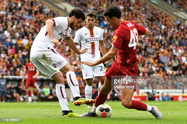 Curtis Jones of Liverpool tackles Anthony O'Connor of Bradford City during the PreSeason Friendly match between Bradford City and Liverpool at...