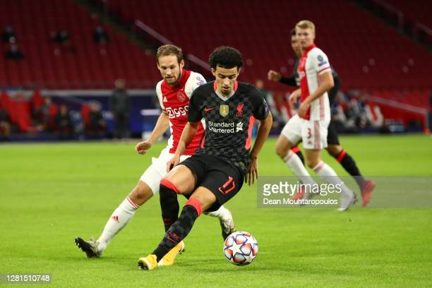 Curtis Jones of Liverpool turns away from Daley Blind of Ajax during the UEFA Champions League Group D stage match between Ajax Amsterdam and...