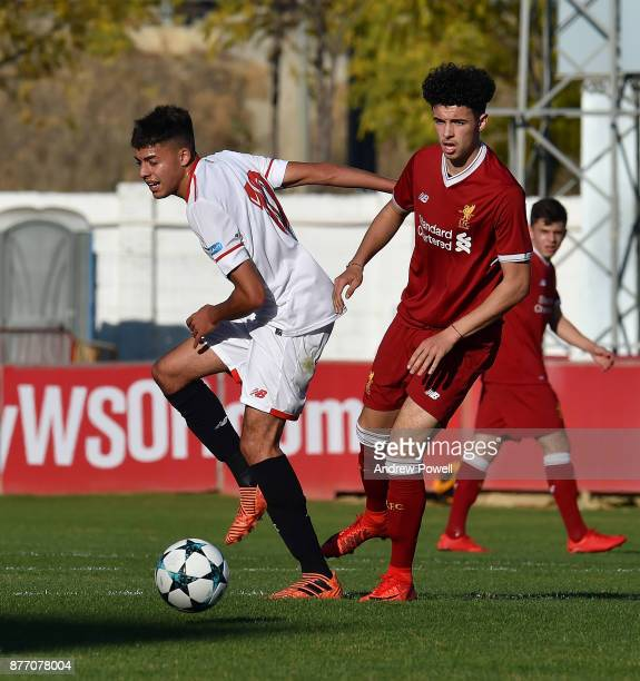 Curtis Jones of Liverpool U19 competes with Charaf of Sevilla FC U19 during the UEFA Champions League group E match between Sevilla FC U19 and...