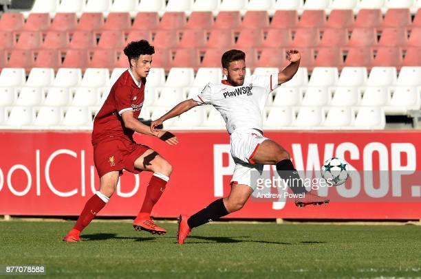 Curtis Jones of Liverpool U19 competes with Mario Espinar Lerida of Sevilla FC U19 during the UEFA Champions League group E match between Sevilla FC...