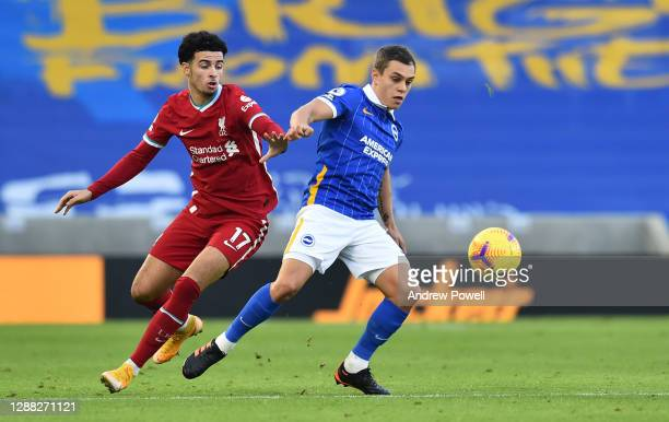 Curtis Jones of Liverpool with Brighton & Hove Albion's Solly March during the Premier League match between Brighton & Hove Albion and Liverpool at...