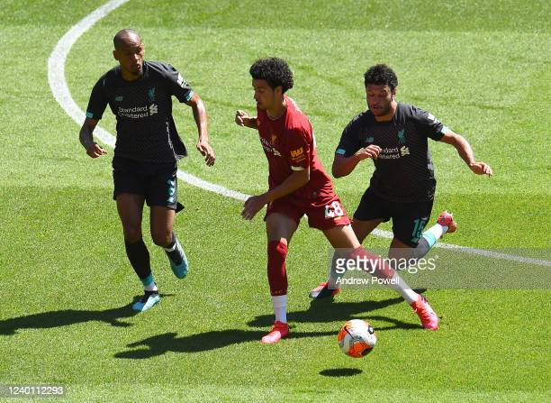 Curtis Jones with Fabinho and Alex OxladeChamberlain of Liverpool during a training session at Anfield on June 01 2020 in Liverpool England
