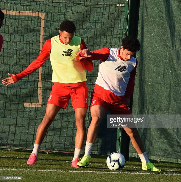 Curtis Jones with Trent AlexanderArnold of Liverpool during a training session at Melwood Training Ground on October 18 2018 in Liverpool England
