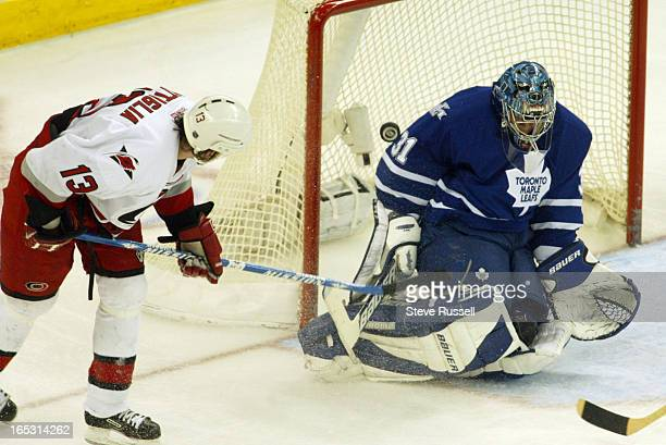 LEAFS05/25/02 Curtis Joseph makes a hugh save on Bates Battaglia as the Toronto Maple Leafs take on the Carolina Hurricanes in Game Five of their...