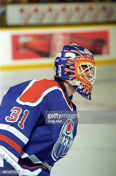 Curtis Joseph of the Edmonton Oilers skates in warmup prior to a game against the Toronto Maple Leafs on April 13 1996 at Maple Leaf Gardens in...