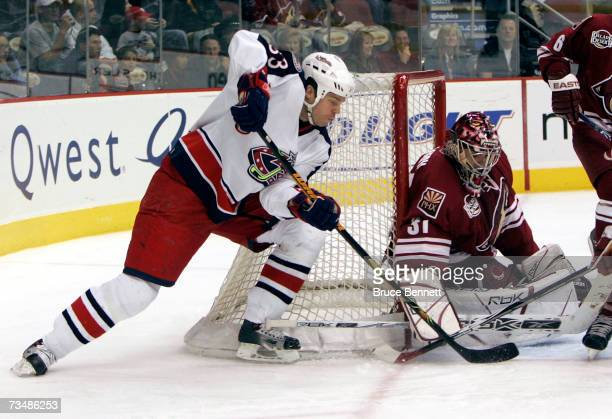Curtis Joseph of the Phoenix Coyotes defends the net from Fredrik Modin of the Columbus Blue Jackets on March 3 2007 at the Jobingcom Arena in...