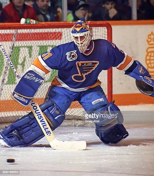 Curtis Joseph of the St Louis Blues stops a shot against the Toronto Maple Leafs at Maple Leaf Gardens in Toronto Ontario Canada on January 6 1992