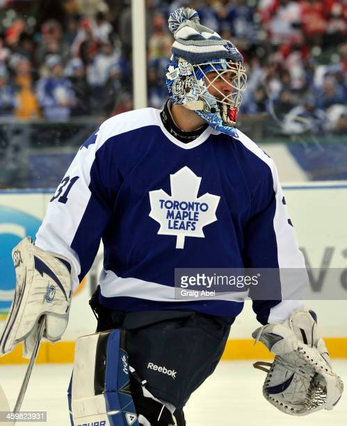Curtis Joseph of the Toronto Maple Leafs Alumni warms up before action against the Detroit Red Wings Alumni during game action on December 31 2013 at...