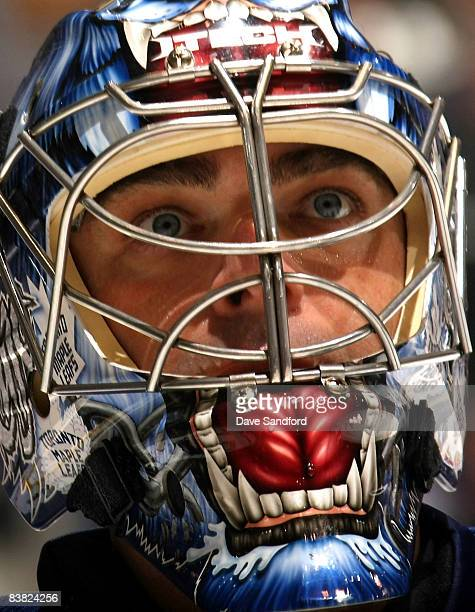 Curtis Joseph of the Toronto Maple Leafs stares into the crowd while there is a break in play against the Atlanta Thrashers during their NHL game at...